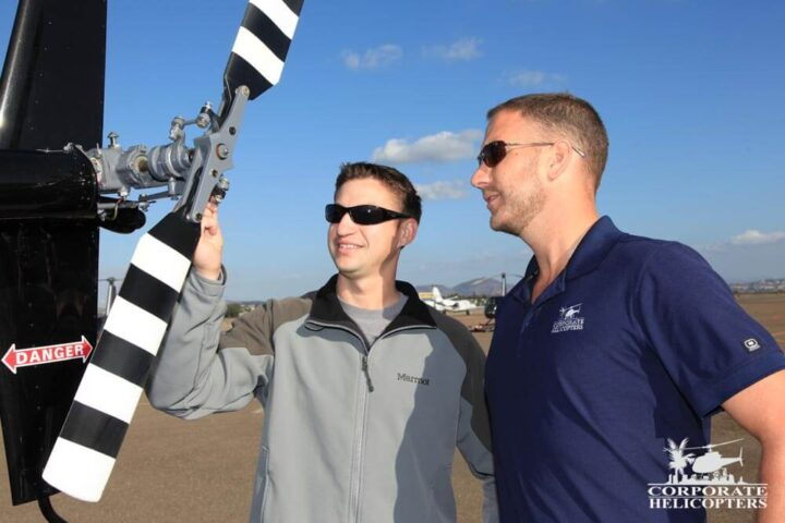 Student and instructor inspect a helicopter tail rotor