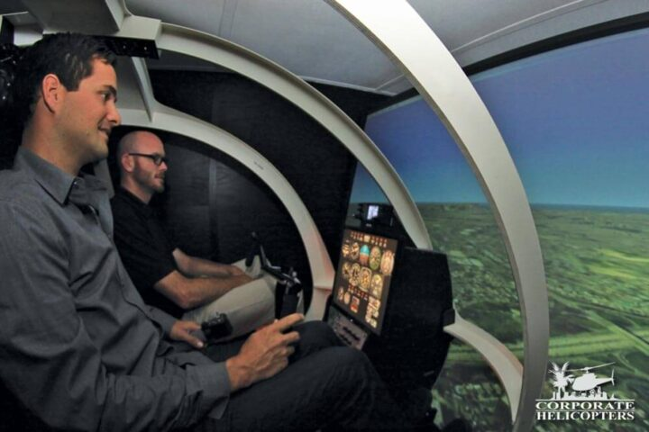 Student and instructor inside a helicopter flight simulator