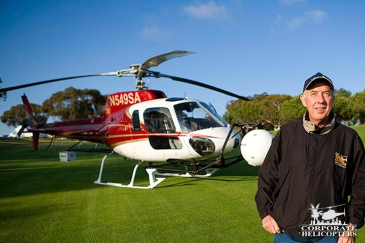 Ivor Shier in front of a helicopter