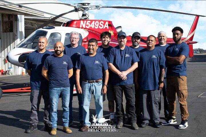 The maintenance staff at Corporate Helicopters poses for a photo