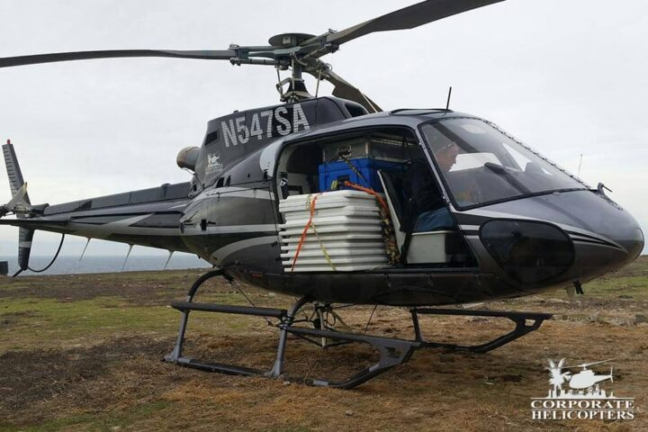 Corporate Helicopters helicopter loaded with supplies on Todos Santos