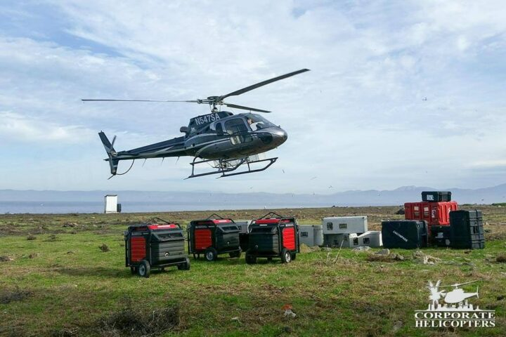 A helicopter landing with supplies on Todos Santos