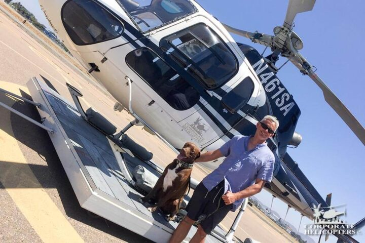 Dog and owner next to a helicopter