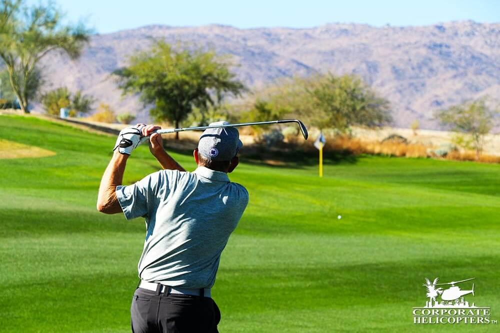 Nice shot: Man inspects golf shot