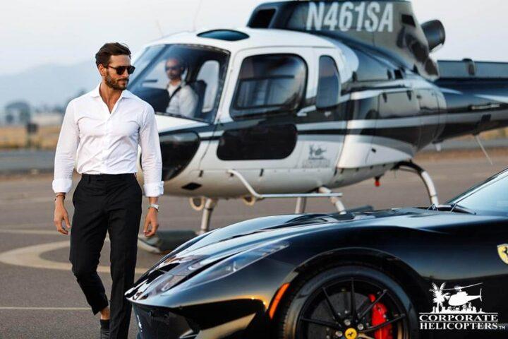 Gentleman exiting helicopter to enter Porsche