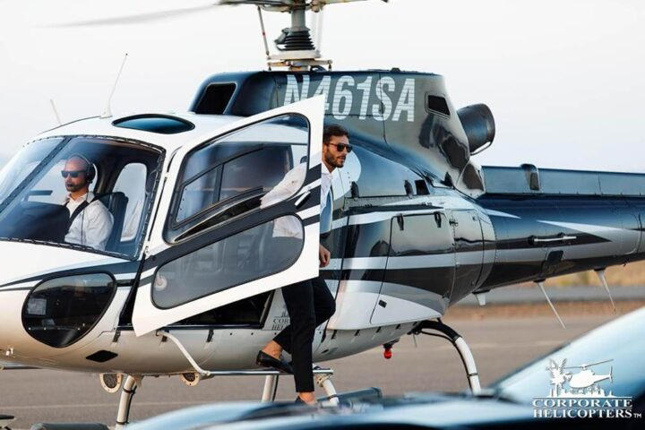 Gentleman exiting a helicopter