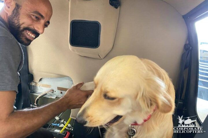 Louie the dog inside of a helicopter with his owner Osama