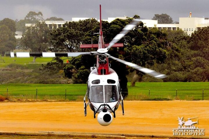 Helicopter with camera mounted on nose takes off