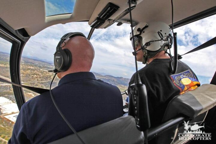 Helicopter cockpit with pilot and instructor